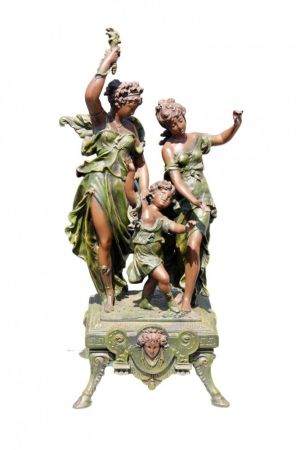 Bronzed Sculpture Of Two Women And A Child.