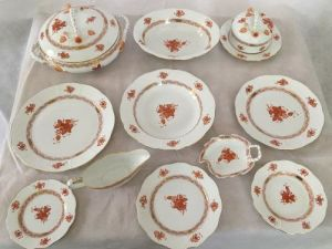 A Herend Chinese Bouquet Rust Dinner Service