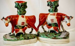 A Pair Of Staffordshire Cow Spill Vases Circa 1840