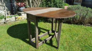 An Early 18th Century Oak Gateleg Table 'faux Drawer' With Oval Top