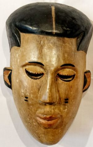 An Oriental Carved Wooden Painted Mask