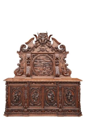 A Large And Impressive Carved Oak Baronial Sideboard