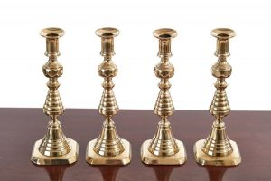 Unusual Set Of Four Antique Brass Candlesticks