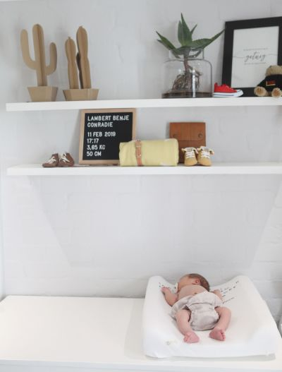 A baby boy lying in his beautiful nursery.
