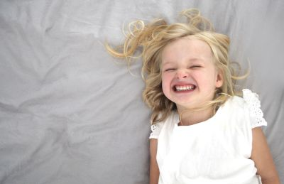 A little girl laughing.