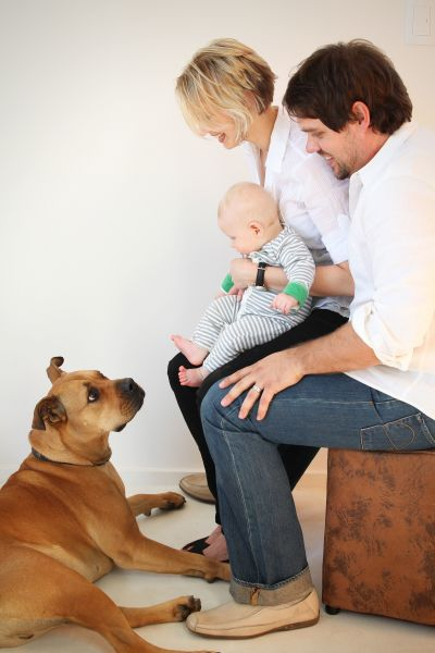 A couple with their baby boy and their dog.