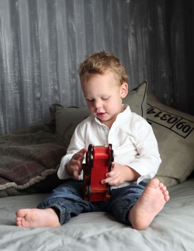 Little boy playing with a toy aeroplane.