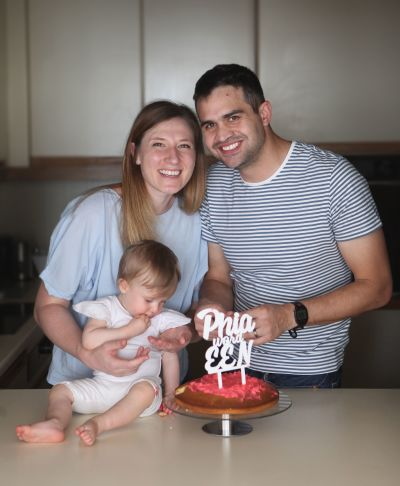 Couple celebrating with their one year old girl.