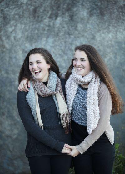 Twin girls posing for a family shoot.