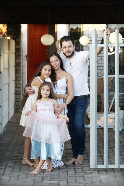 A family at their front gate during lockdown.