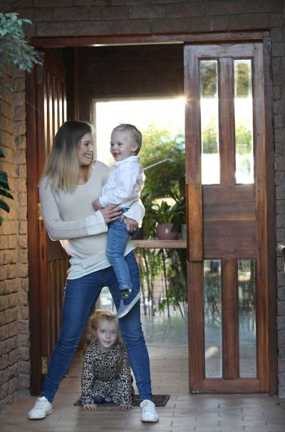 A mom with her children at home during lockdown.