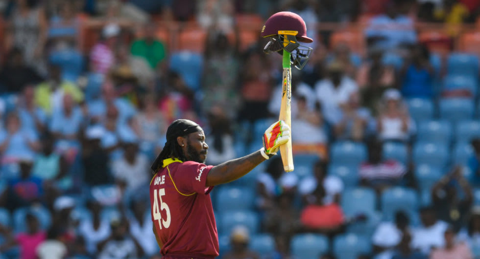 Chris Gayle of West Indies celebrates achieving 10,000 ODI runs.
