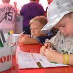 two boys coloring at canon station