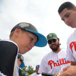 phillies player giving autographs to ll players
