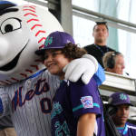 ll player with mets mascot