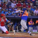 mets player swinging bat