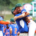 great lakes player hugging coach