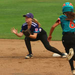 softball player catching ball on second