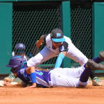 nw first baseman tagging out sliding player
