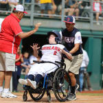 challenger game - buddy pushing player in wheelchair home