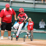 challenger game - player in wheelchair heading to first