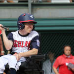 challenger game - player in wheelchair hitting ball