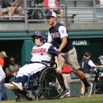 challenger game - player with wheelchair heading to home plate