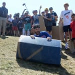 Cubs player sliding down the hill on cardboard