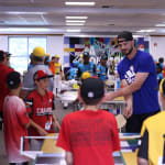 Cubs player playing ping pong with teams