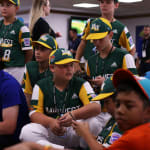 Cubs player playing video games with teams