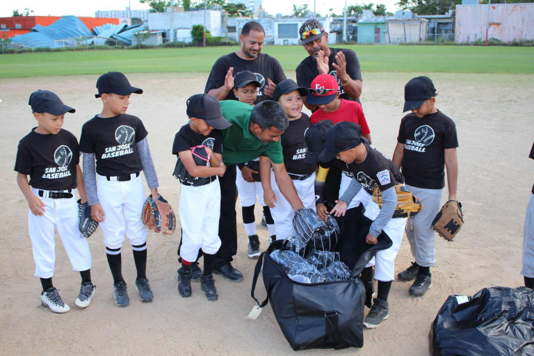 Little Leaguers receive brand new gloves.