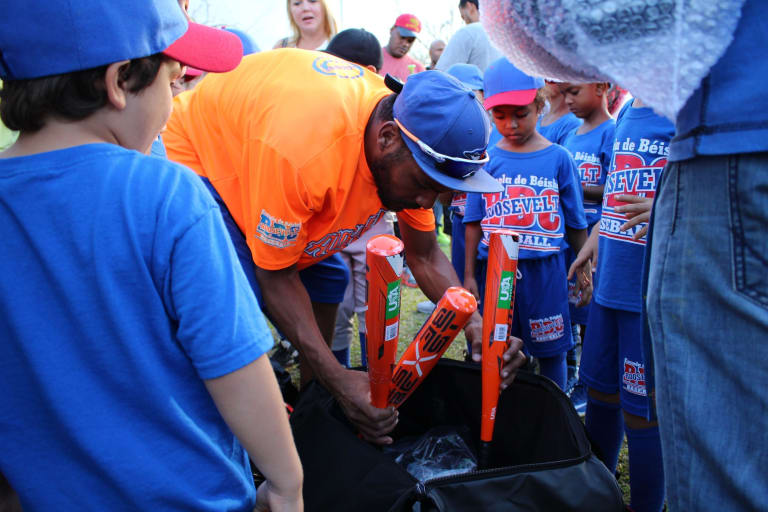Little Leaguers receive brand new bats.