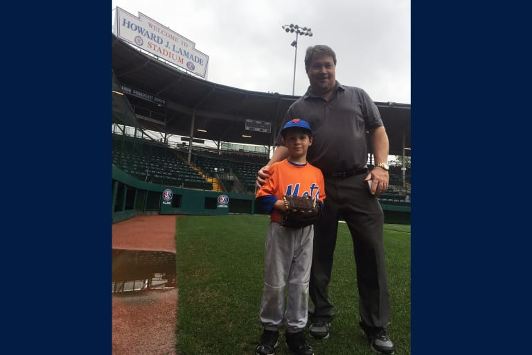 Stephen and his son join together for a shot on Lamade Stadium