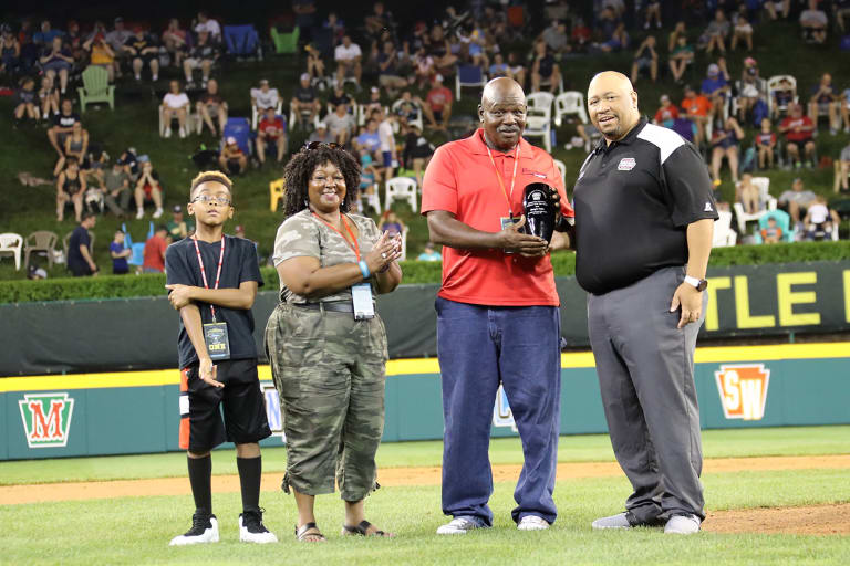 urban initiative award winner holding award