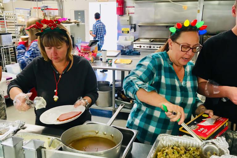 west 2018 christmas party volunteers cooking
