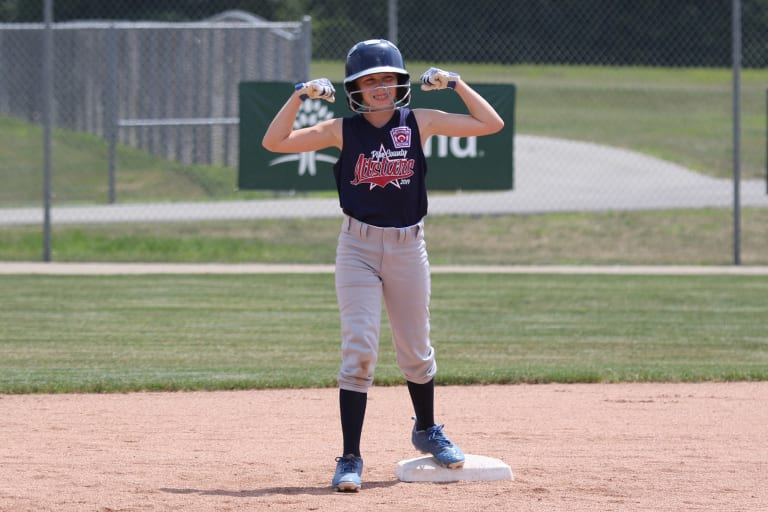 player on base showing her muscles