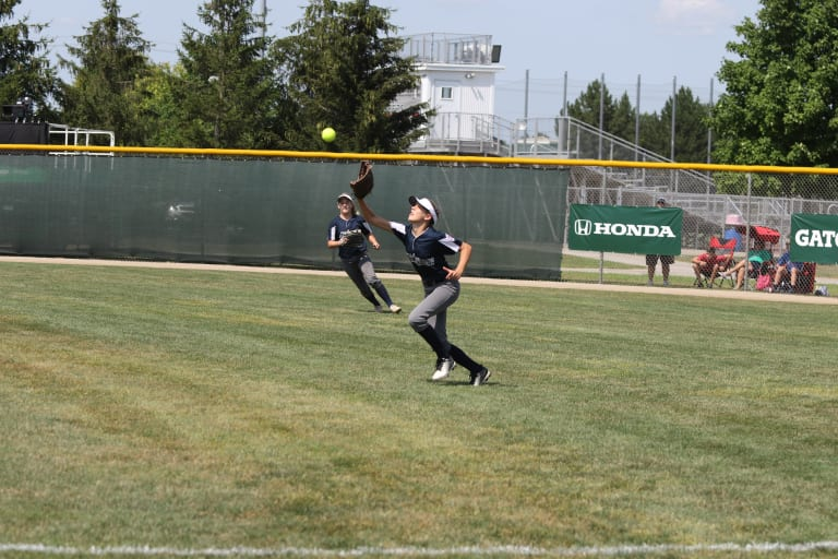 outfielder running to catch ball