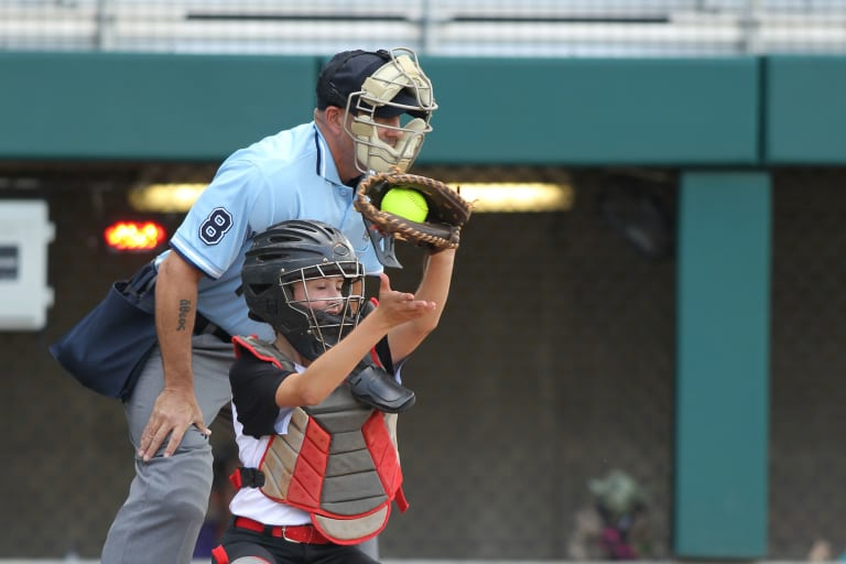 catcher catching ball, umpire behind