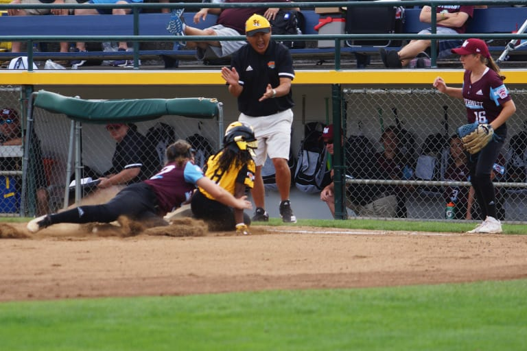 SW sb fielder tagging for an out