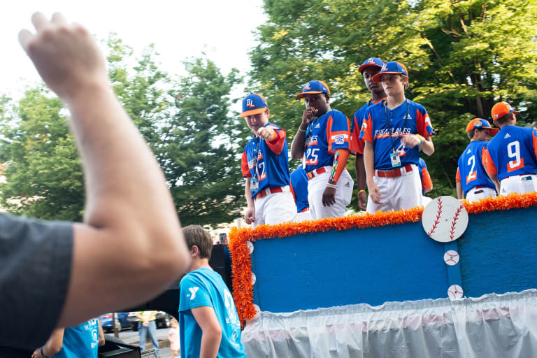 Great Lakes team riding parade float