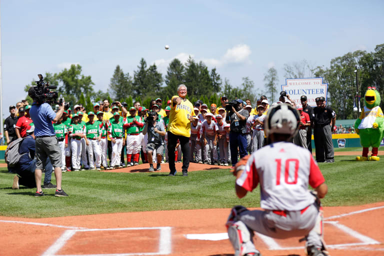 Clint Hurdle (pirates manager) throwing first pitch to Japan catcher
