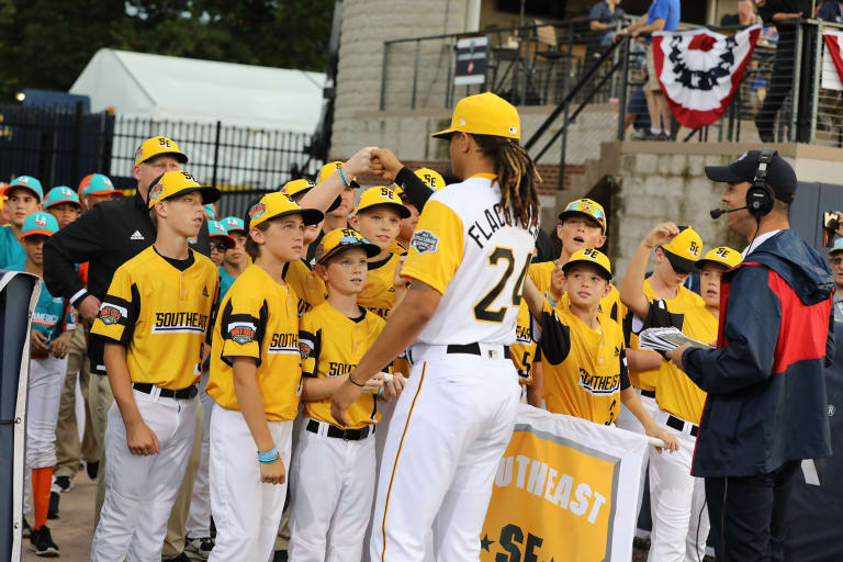 pirates player fist bumping se team mlb ll classic