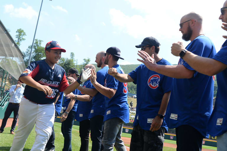 Mid-Atlantic player highfiving Cubs players