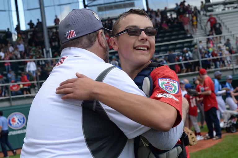 catcher hugging coach