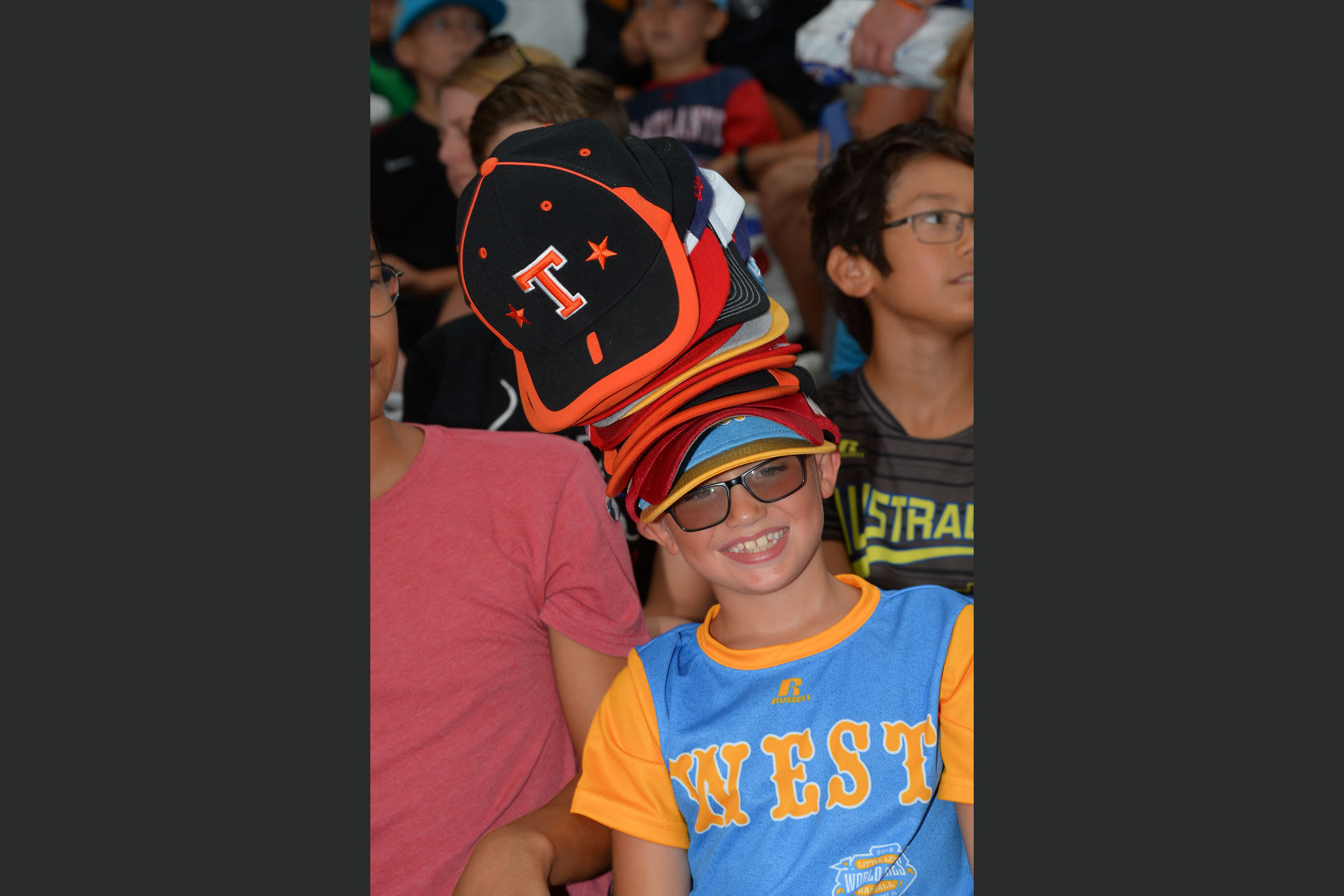 llbws fan with lots of hats on head