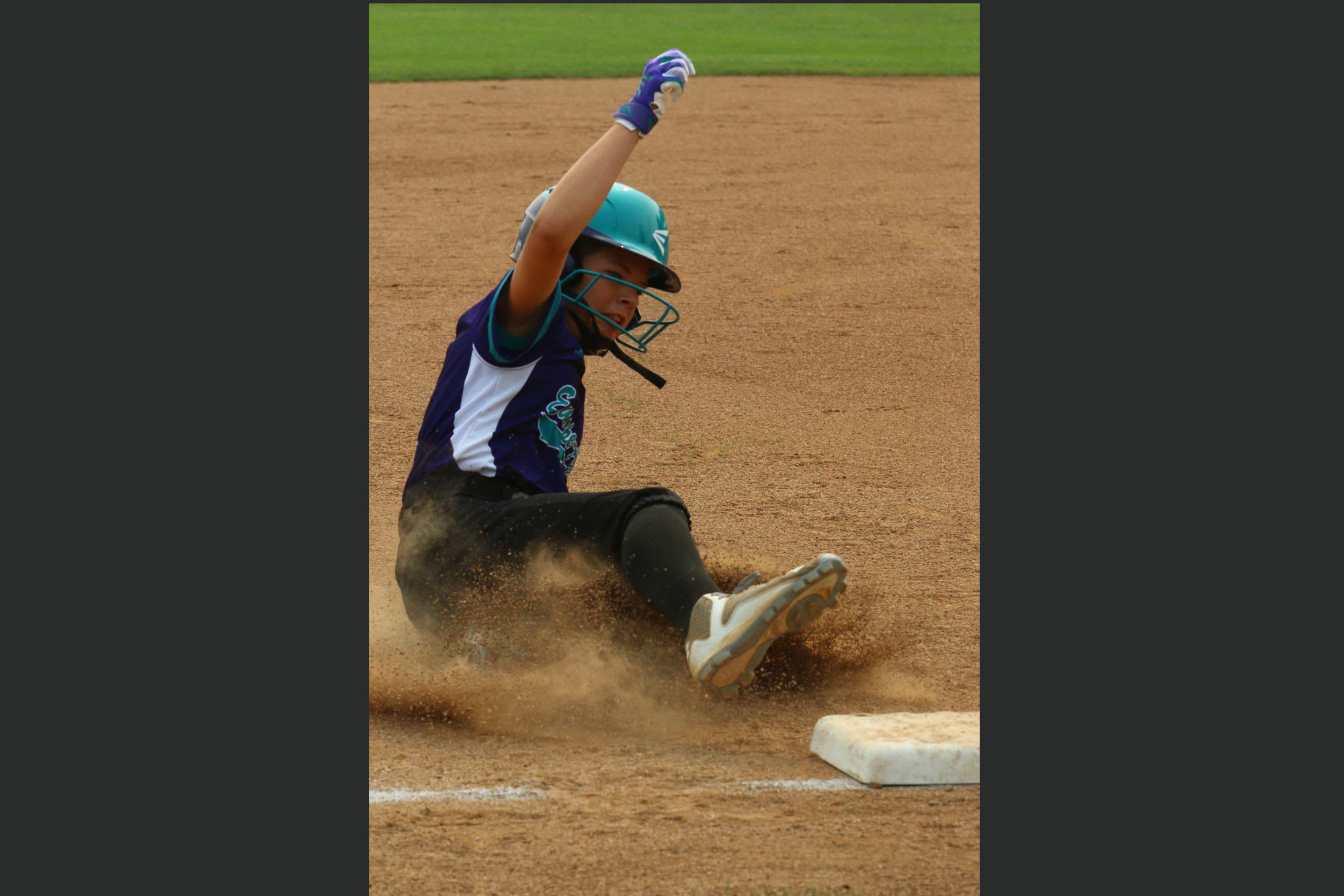 softball player sliding into base