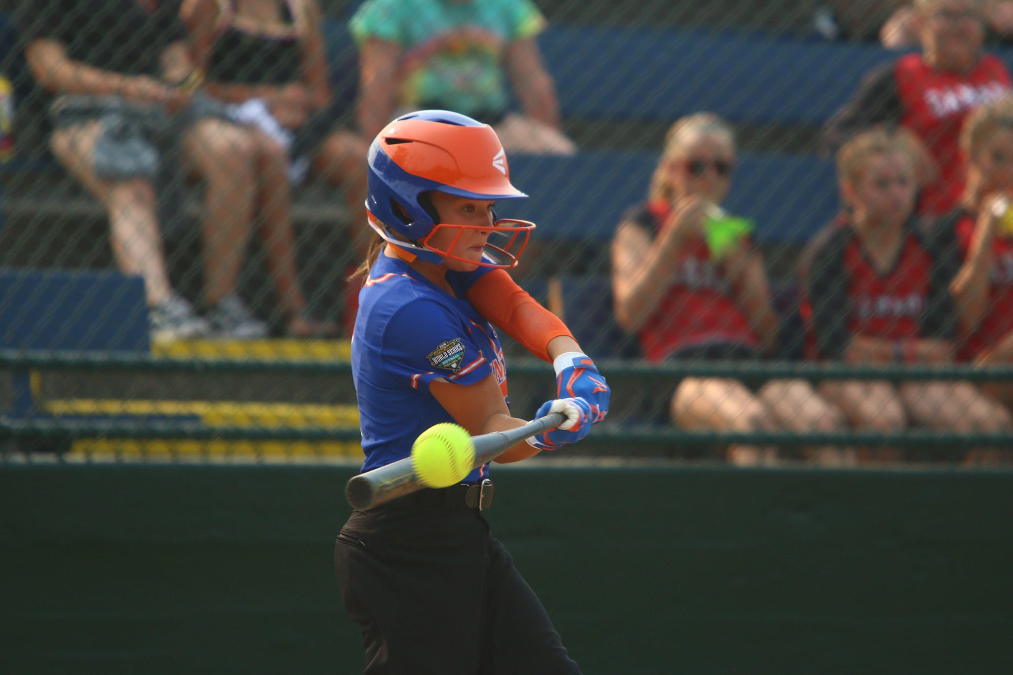 softball batter hitting ball