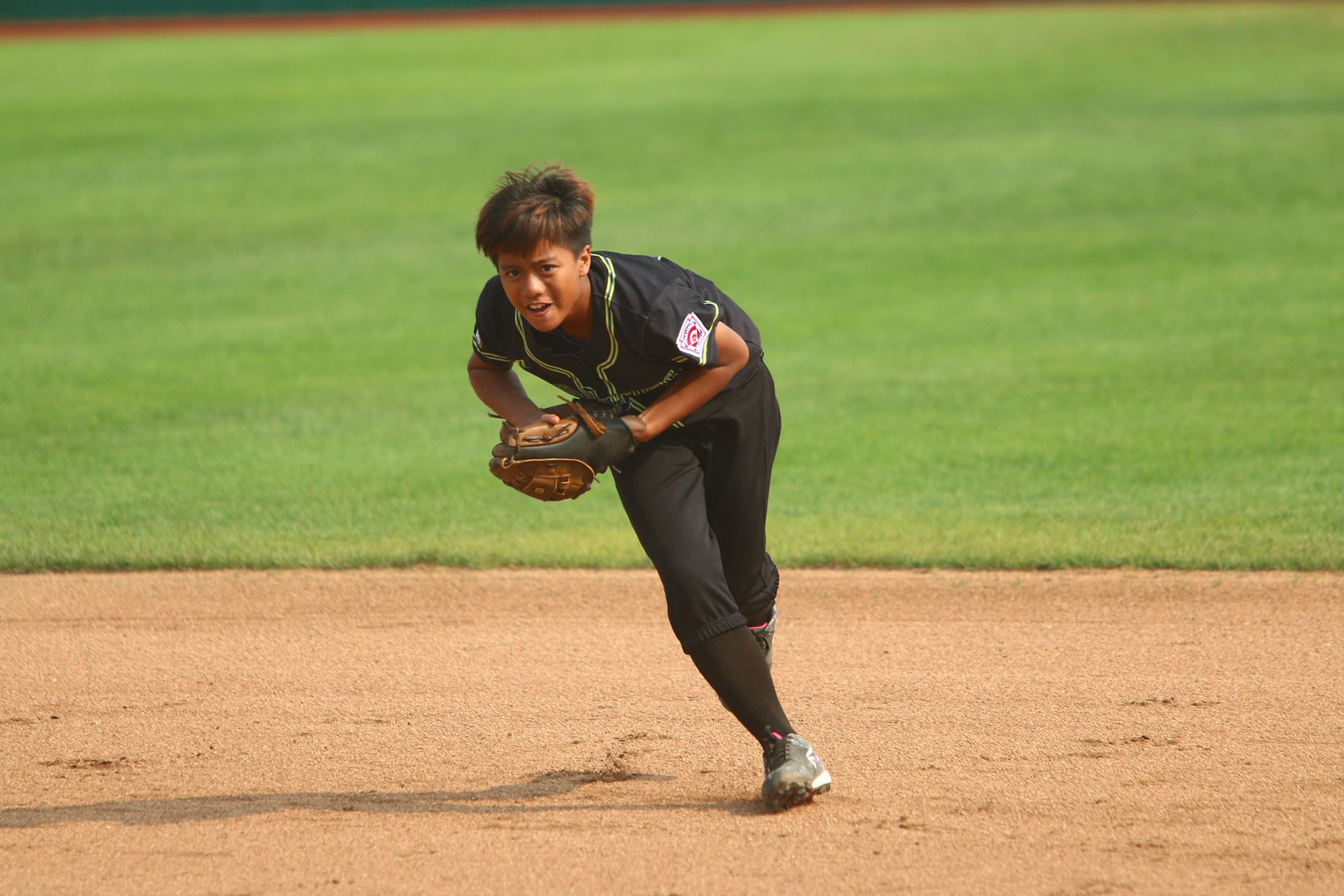 softball player throwing ball