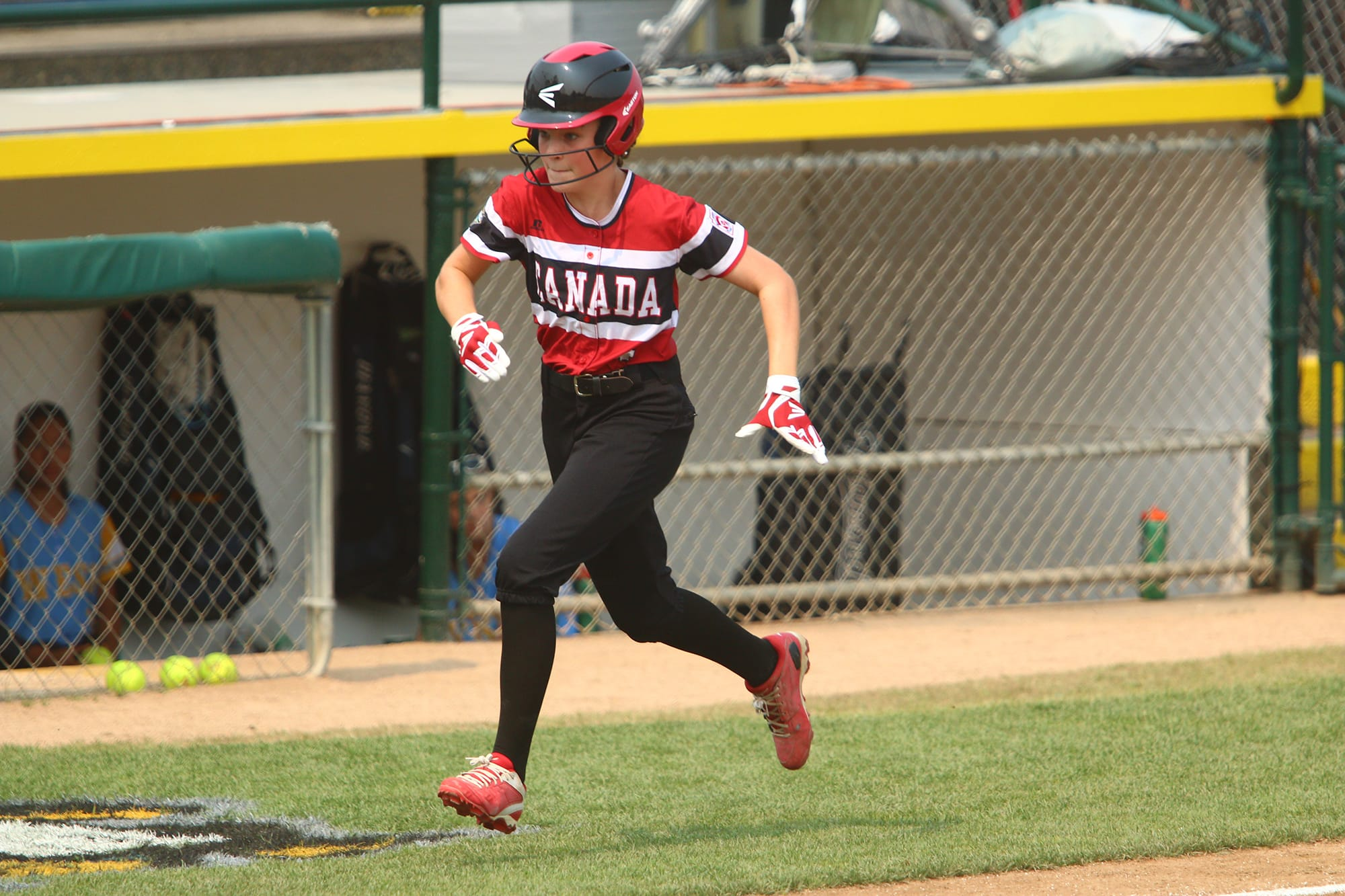softball player running home