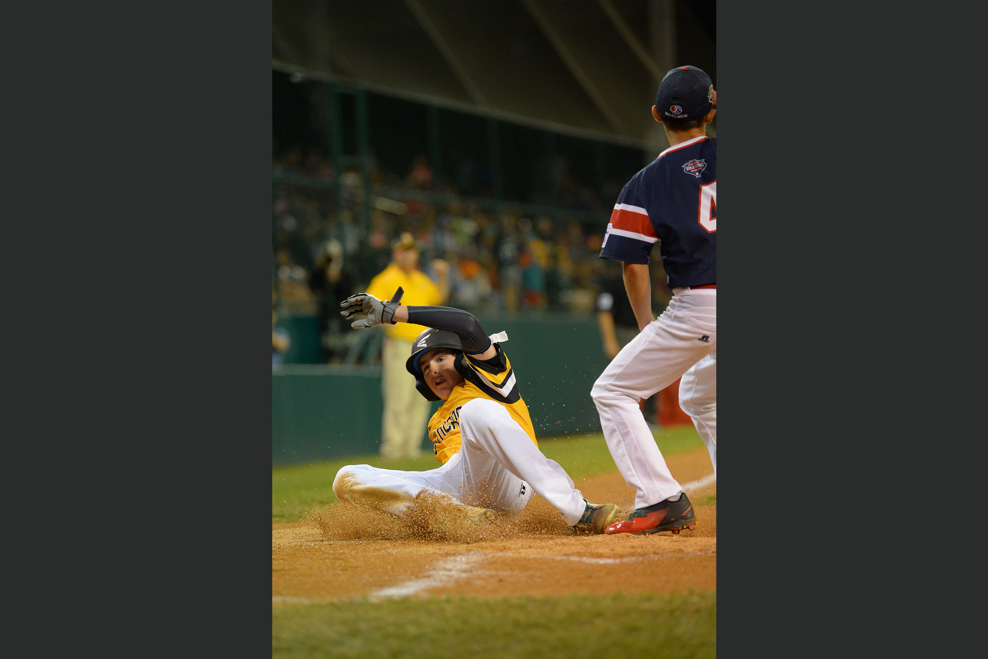 southeast player sliding home